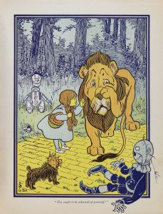 Dorothy meets the Cowardly Lion, from the first edition.